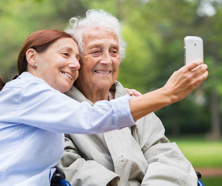 Women taking a photo together.