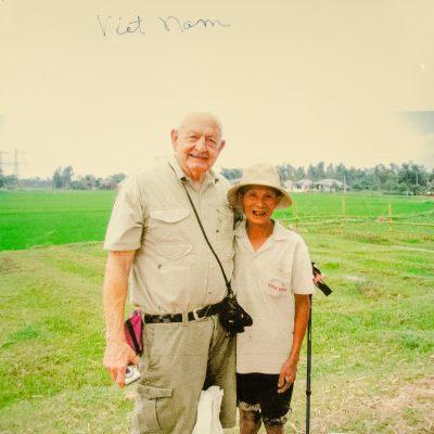 Two men in a field.